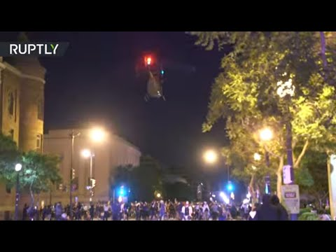 Show of force?   MILITARY HELICOPTER disperses protesters defying curfew in DC