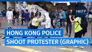 Hong Kong Police Shoot Black-clad Protester In Stomach