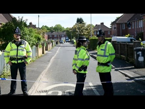 British police raid houses in Manchester