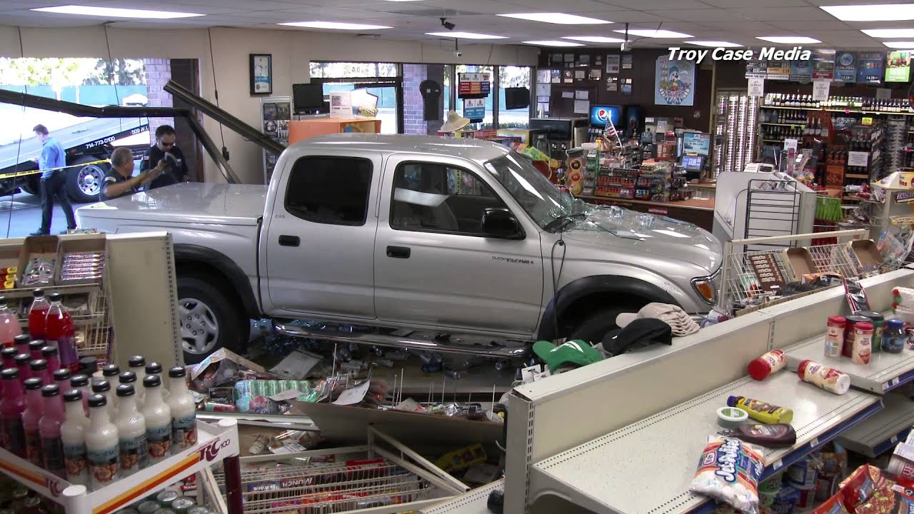 Car Crashes Through Store