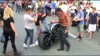 funny motorcycle harley v rod crash euro muscle man attempts to save face in front of audience
