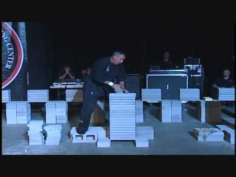 Robert Anderson- Elbow through 12 concrete patio blocks