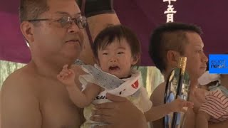 Japan: the sumo lifting event with a prize for making babies cry