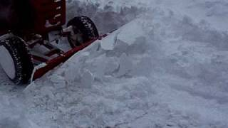 C141 Wheel Horse plowing snow