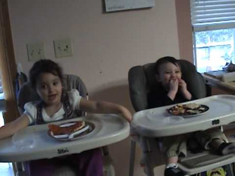 kids playing, singing, and sort of eating in the high chairs
