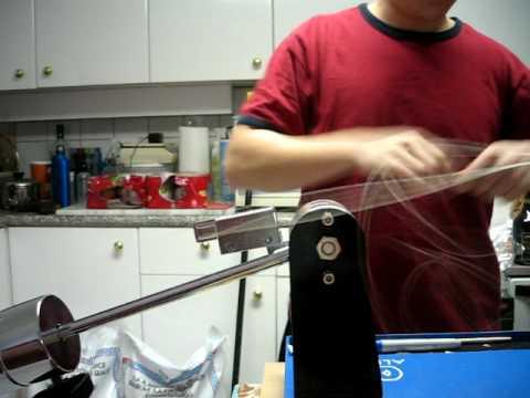 Applying tension on a drop-weight stringing machine w/ clutch
