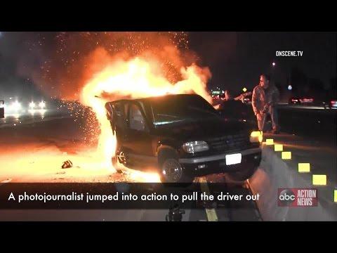 WATCH | Cameraman heroically pulls man from burning car