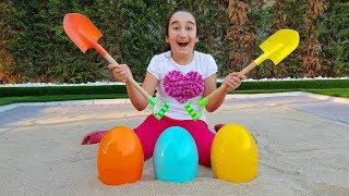 Finding surprise eggs in sandbox, funny kid video