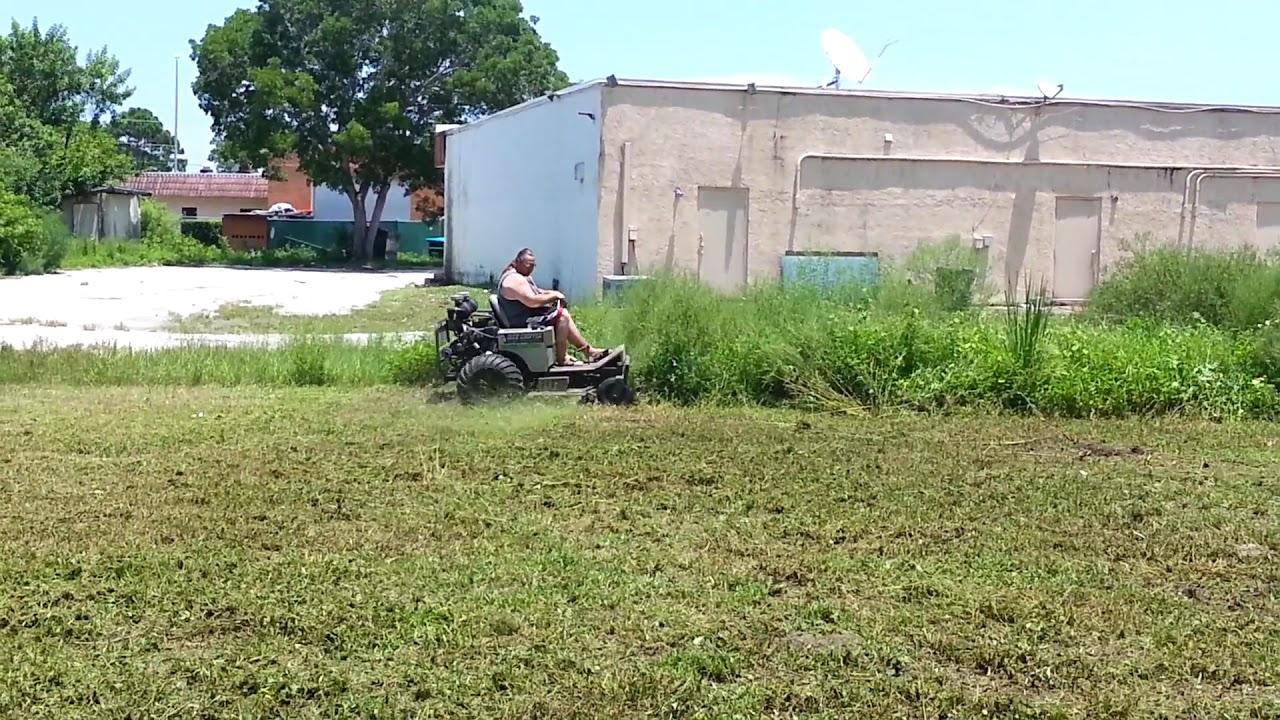 Dixie chopper cuts some tall grass
