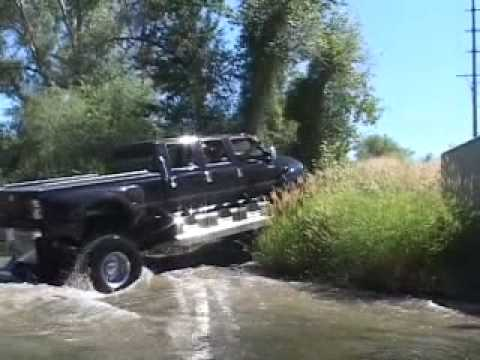 F 650 4x4 Six Door Pickup Driving Next To The Road Youtube