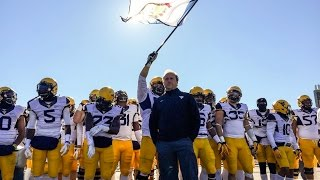 Only 35 of 127 players listed on west virginia university's football roster hail from the mountain state. rest had to learn what it meant represent we...