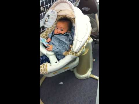 7 month old Matthew on a swing at Babies R Us