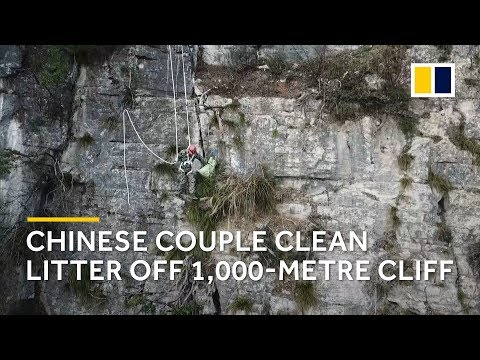 Dangerous: Chinese cleaners couple risk their lives to keep mile-high cliffs spotless