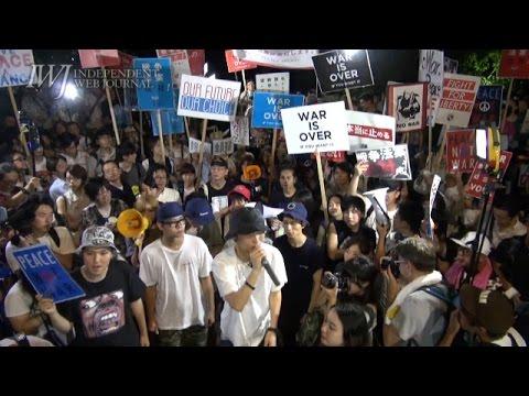 「民主主義ってなんだ」「これだ!」猛暑の国会前で安保法制反対抗議
