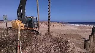 Driving poles in for new boardwalk in Ocean Grove New Jersey.