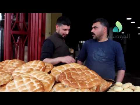 Business people bustle after Iraqi troops liberate east of Mosul from the Daesh part 4