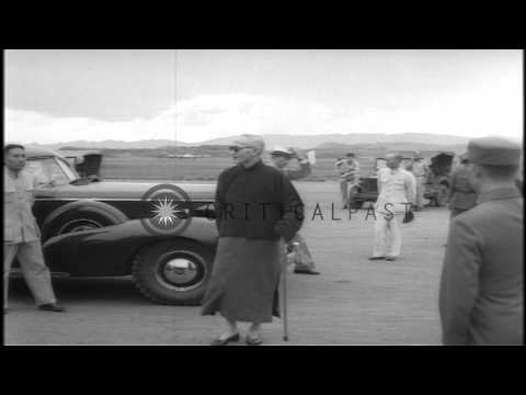 Madame Chiang Kai-shek is greeted by people at Chungking Airport after returning ...HD Stock Footage