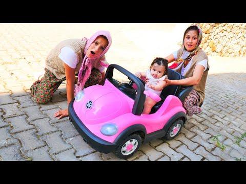 Fındık ailesi bebek Defne için araba alıyor. Eğlenceli video