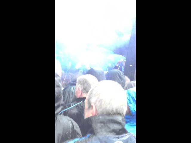 Man city fans let off a smokebomb in the green man
