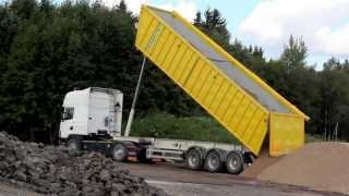 346 Yellow dump truck unloading soil in the site