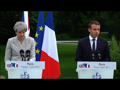 May assures Macron