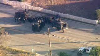 Officers appear to move in on San Bernardino suspects