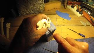 Hand filing work on a maori whale bone manaia pendant.