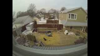 American Tundra Shepherd and three male puppies howling at tornado ...