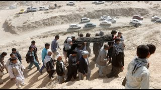 Afghans hold funeral prayers for Muslims killed in mosque attacks