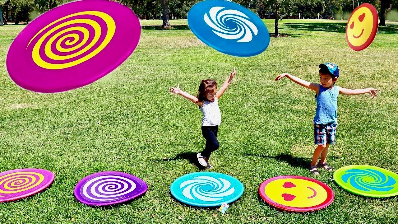 Toddlers Playing HUGE Frisbee Toys at the Park - Learn Colors with ...