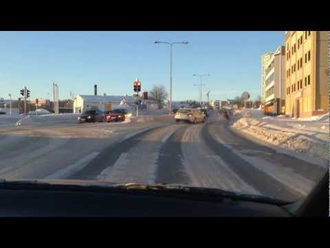 Driving on a sunny winter day in Finland, Rovaniemi
