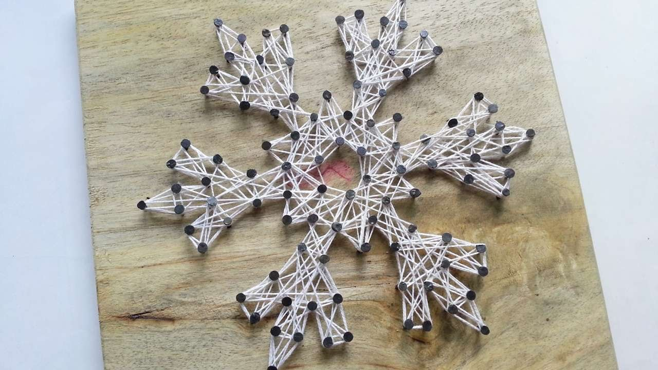 How to create a snowflake string art diy home tutorial how to create a snowflake string art diy home tutorial guidecentral youtube baditri Image collections