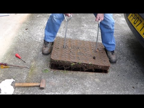 How to lift drain covers. (Man hole covers) to clear blocked drains.