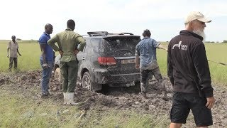 Driving on slick earth roads • Expedition truck • World tour