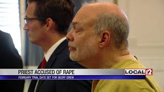 Judge sets trial date for priest accused of rape