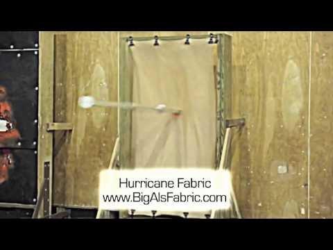Hurricane Fabric vs. Wood and Metal Panels -- Impact Demonstration