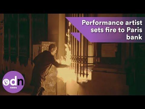 Performance artist sets fire to Paris bank