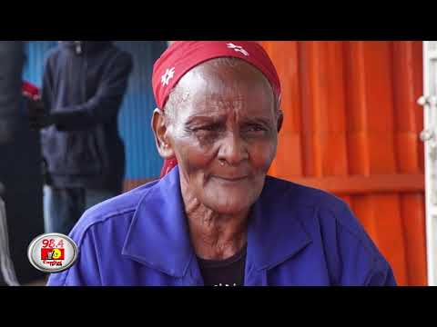 Shosh, 78, works alongside her great-grandsons at a Nairobi audio system shop