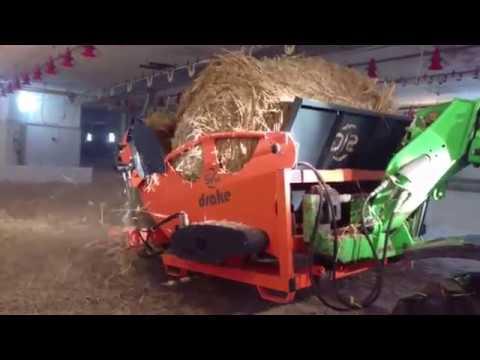 SIG DRAKE straw bale bedding unroller
