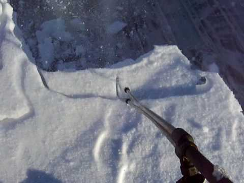 Roof snow removal with pressure washer - YouTube