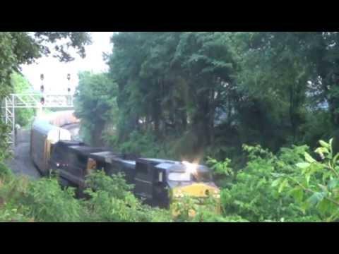 Acworth Ga 6-5-15 with an ex-Conrail and an Idiot Truck Driver