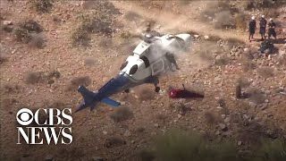 helicopter-rescue-goes-out-of-control-as-basket-with-hiker-inside-spins-wildly