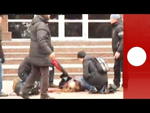 Graphic footage: Woman shot as Ukraine protesters storm security service building
