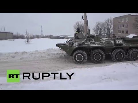 Russia: Russian Army BTR-80 APC rescues lorry trapped in snow