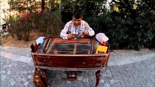 Street musicians of Greece Athens Crete gypsy cimbalom and a cool ass dog with popcorn buddy