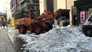 DSNY, NEW YORK CITY DEPARTMENT OF SANITATION, USING FRONT LOADER & DUMP TRUCKS TO REMOVE SNOW.