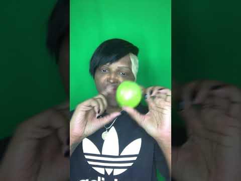 Biting green apple