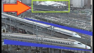 高輪ゲートウェイ駅をバックに東海道新幹線N700系がV字交差する再開発エリアの景色