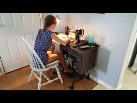 Marin learning to sew on treadle.