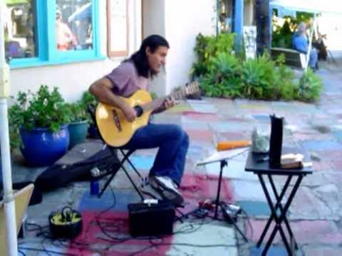 Ruben De Anda covers Santana's 'Oye Como Va' in the Spanish Village